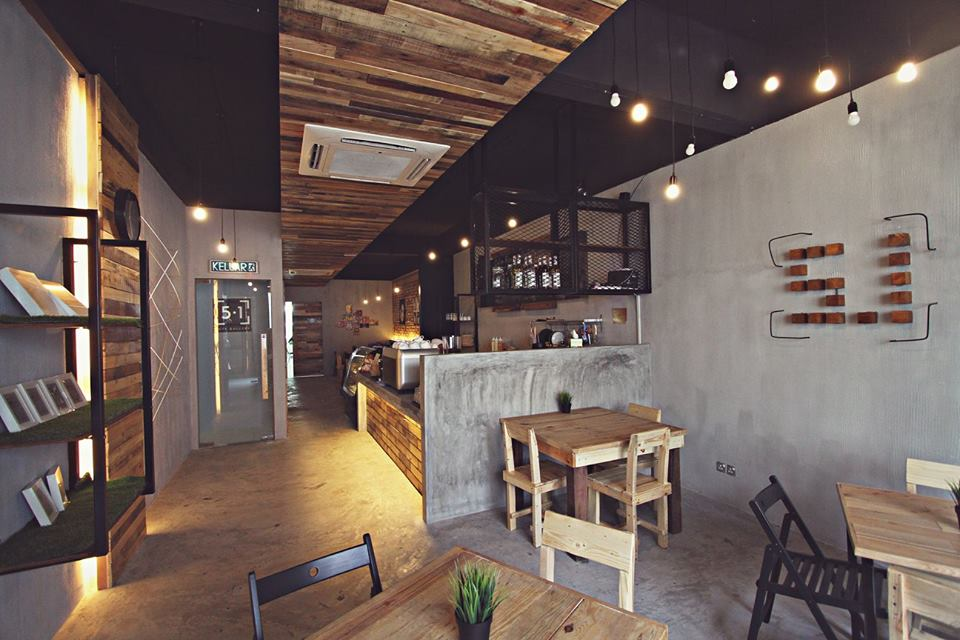 Even From Afar One Will Be Able To Identify The Location Of Cafe Just By Judging Uniquely Designed Exterior Wall Filled With Rustic Wood And